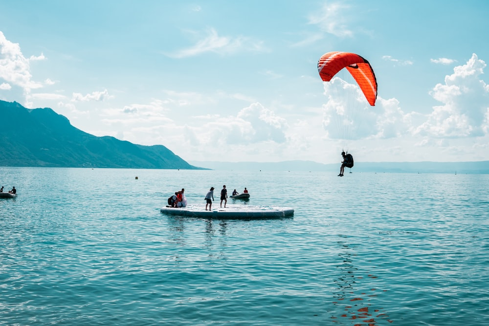 person doing paragliding during daytime