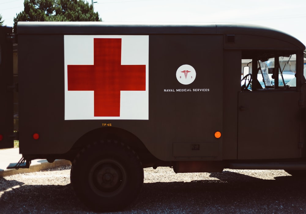 black and red Ambulance truck