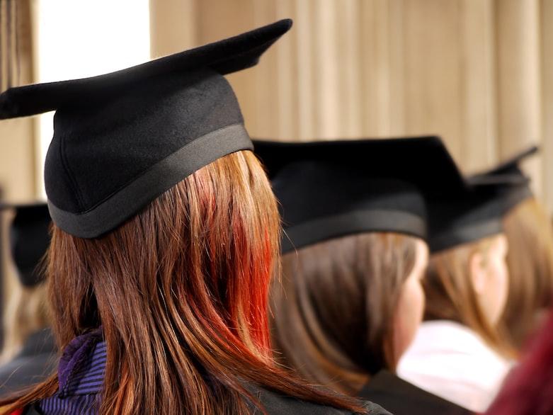 women on square academic caps