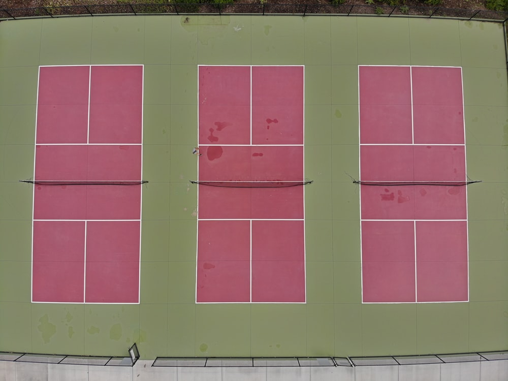 three red and green tennis courts