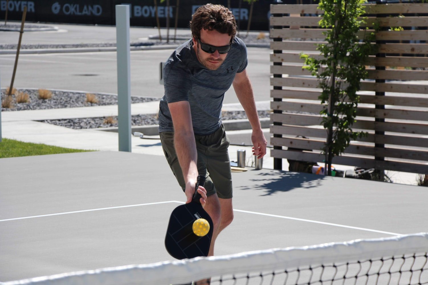 Man wearing a shirt playing pickleball