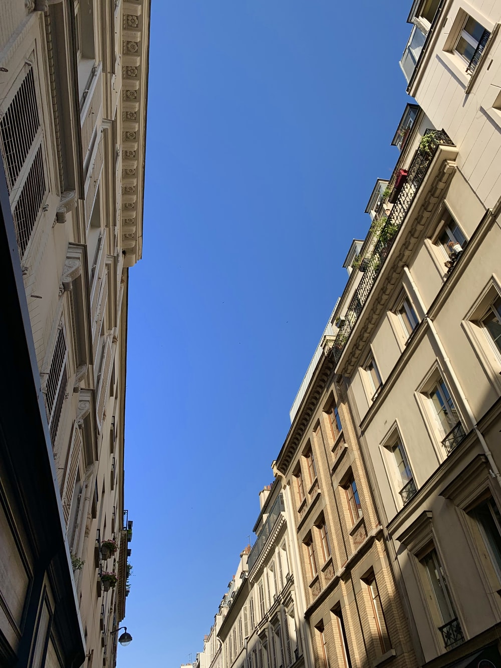 brown apartment buildings under clear blue sky