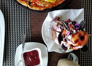 pizza and dessert on table