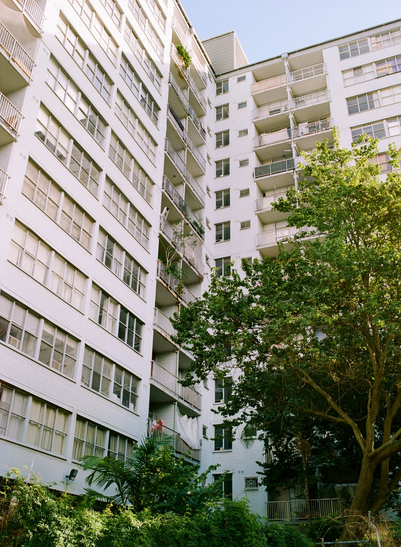 white concrete buildings close-up photography