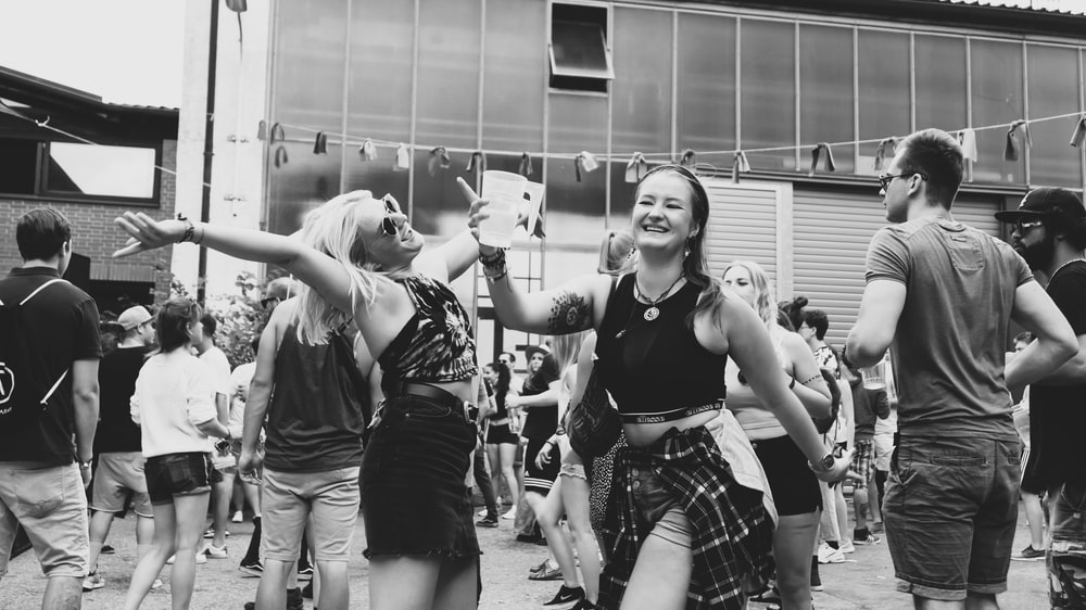grayscale photo of people dancing