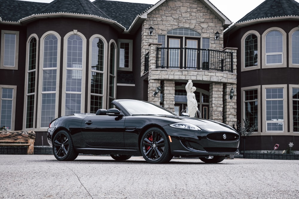 black convertible vehicle parked outside house