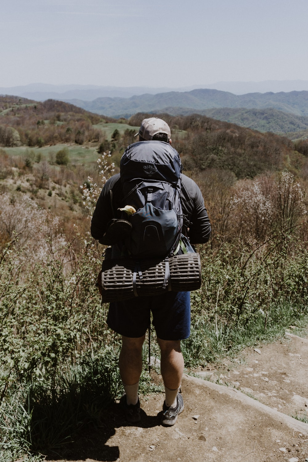 man carrying black backpack