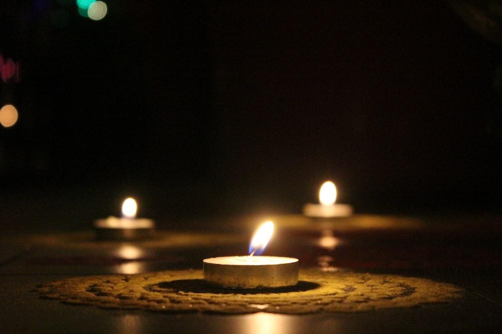 three white tealight candles