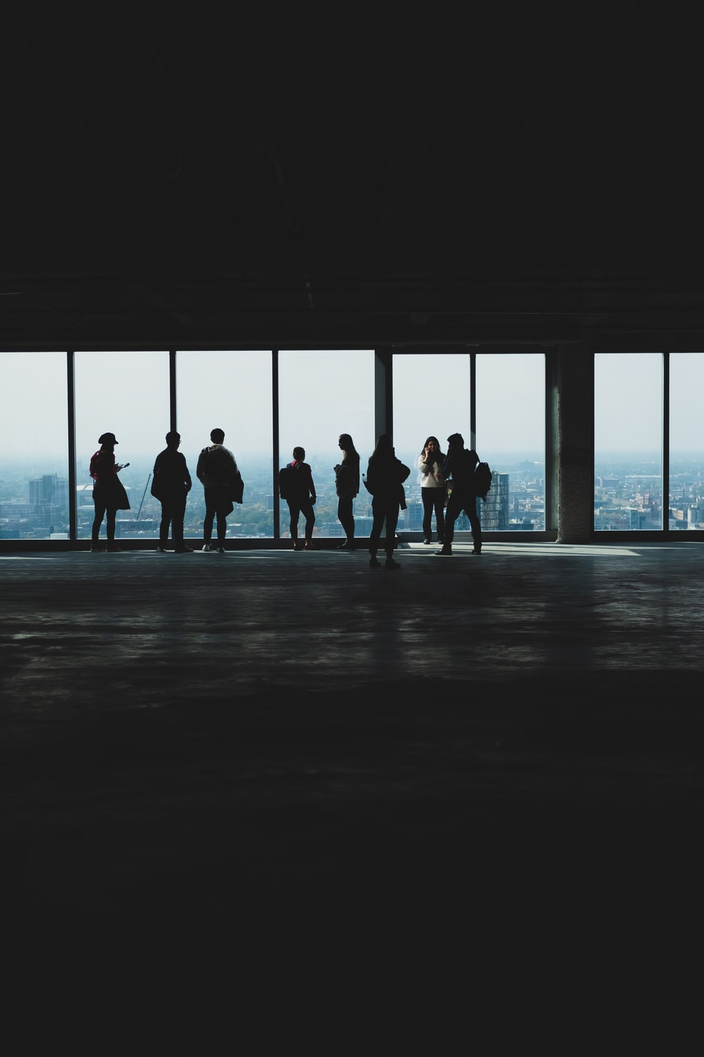 silhouette photography of people in tower