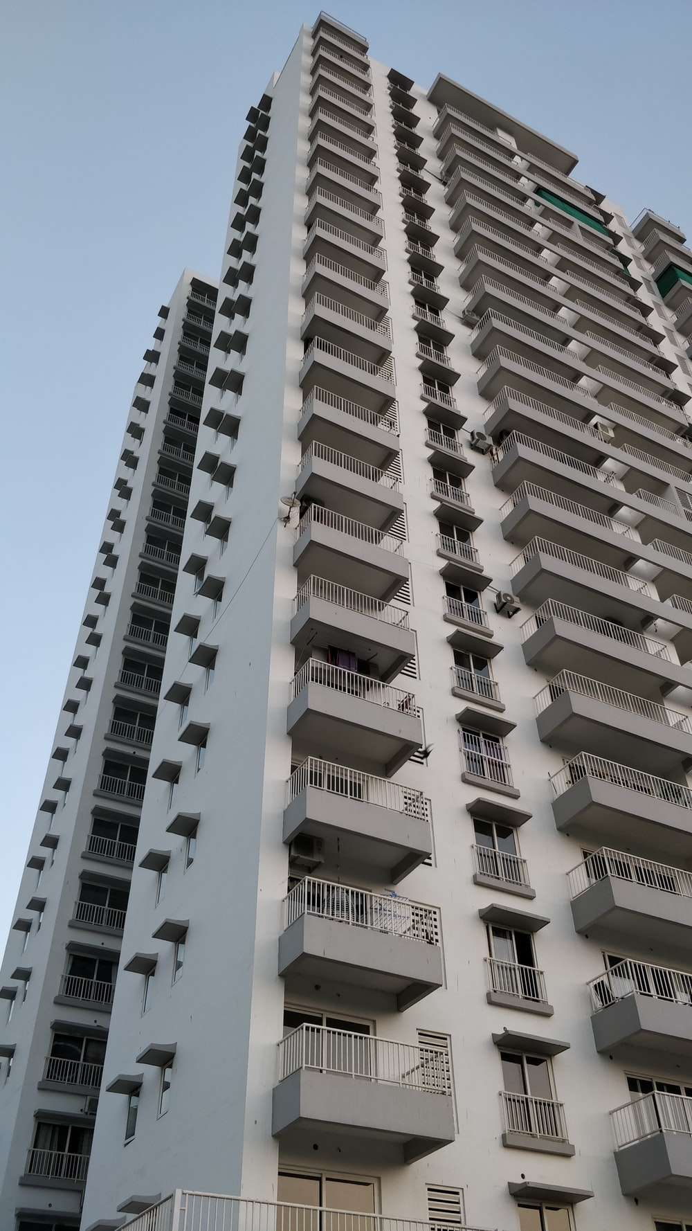 low-angle photography of white and gray concrete high-rise building