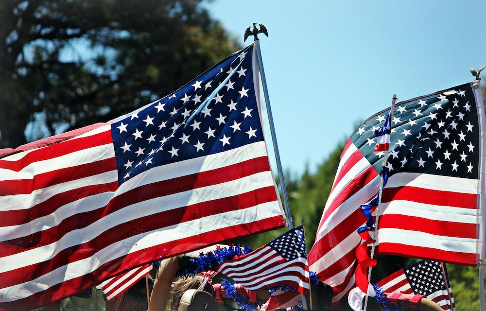 shallow focus photo of flag of USA