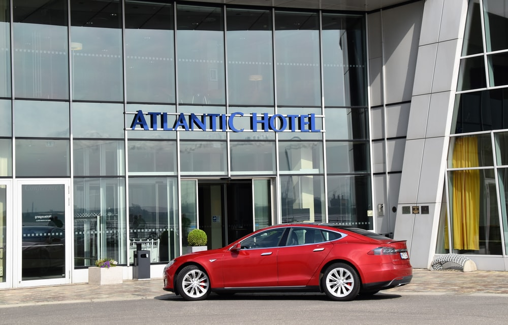 red sedan outside Atlantic Hotel