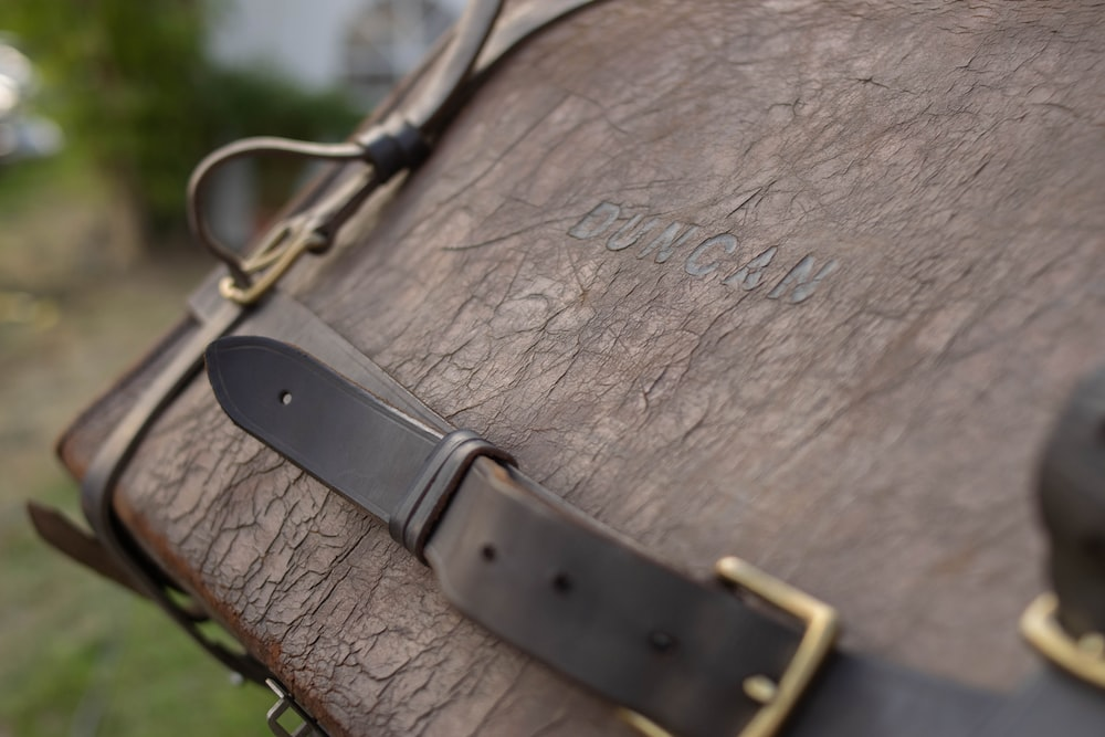 shallow focus photography brown leather case
