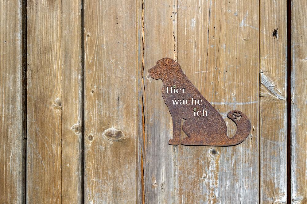 brown metal dog wall decor