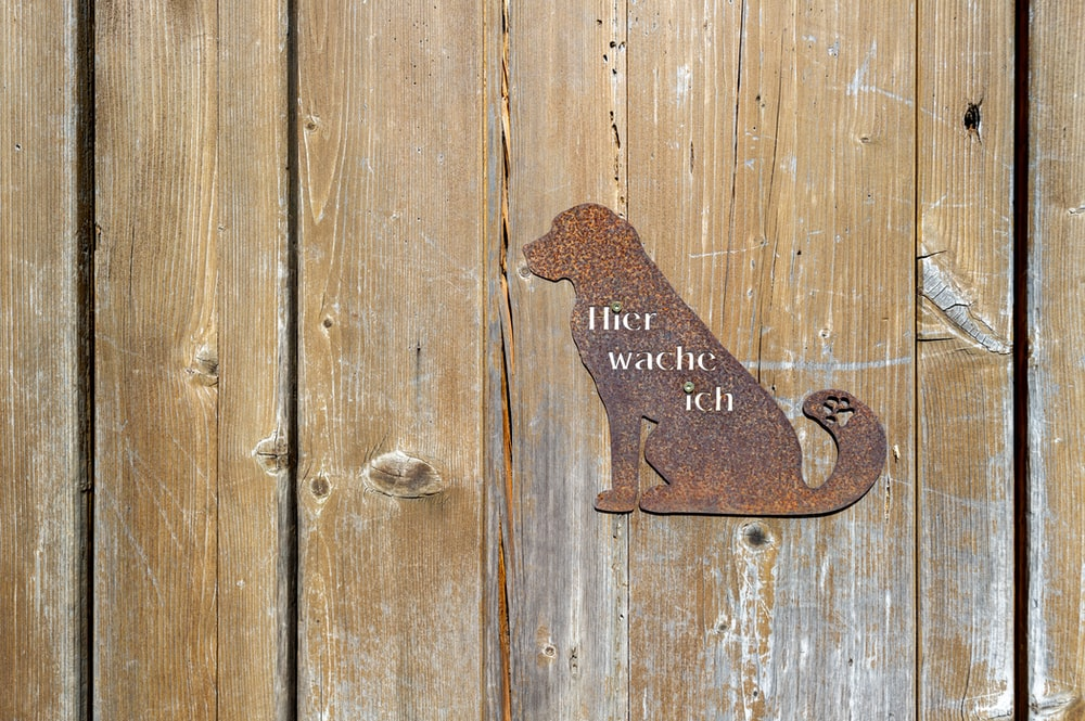 brown metal dog wall decor