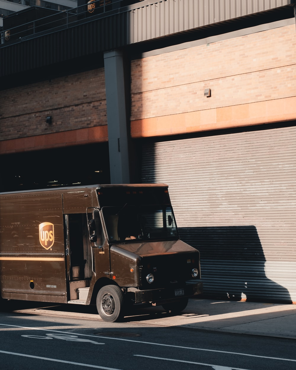 black van parked near near building