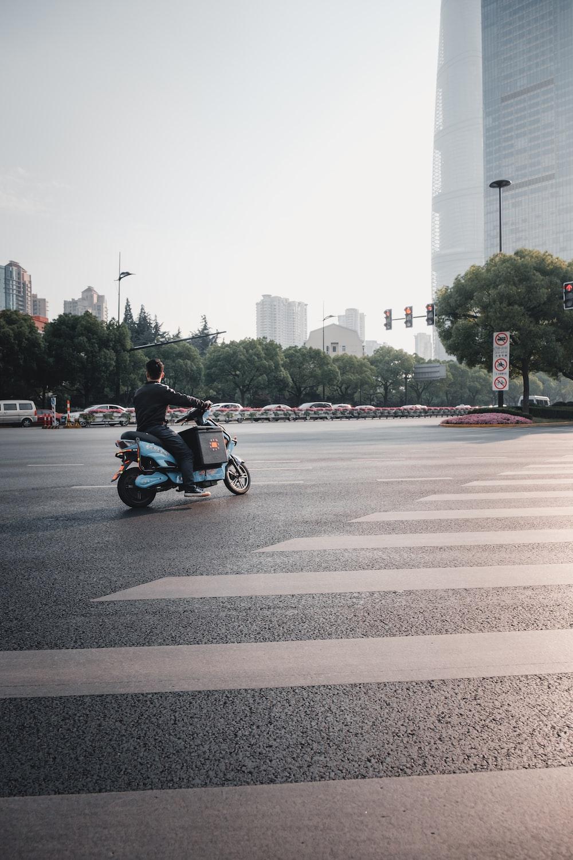 man riding motorcycle near pedestrian lane