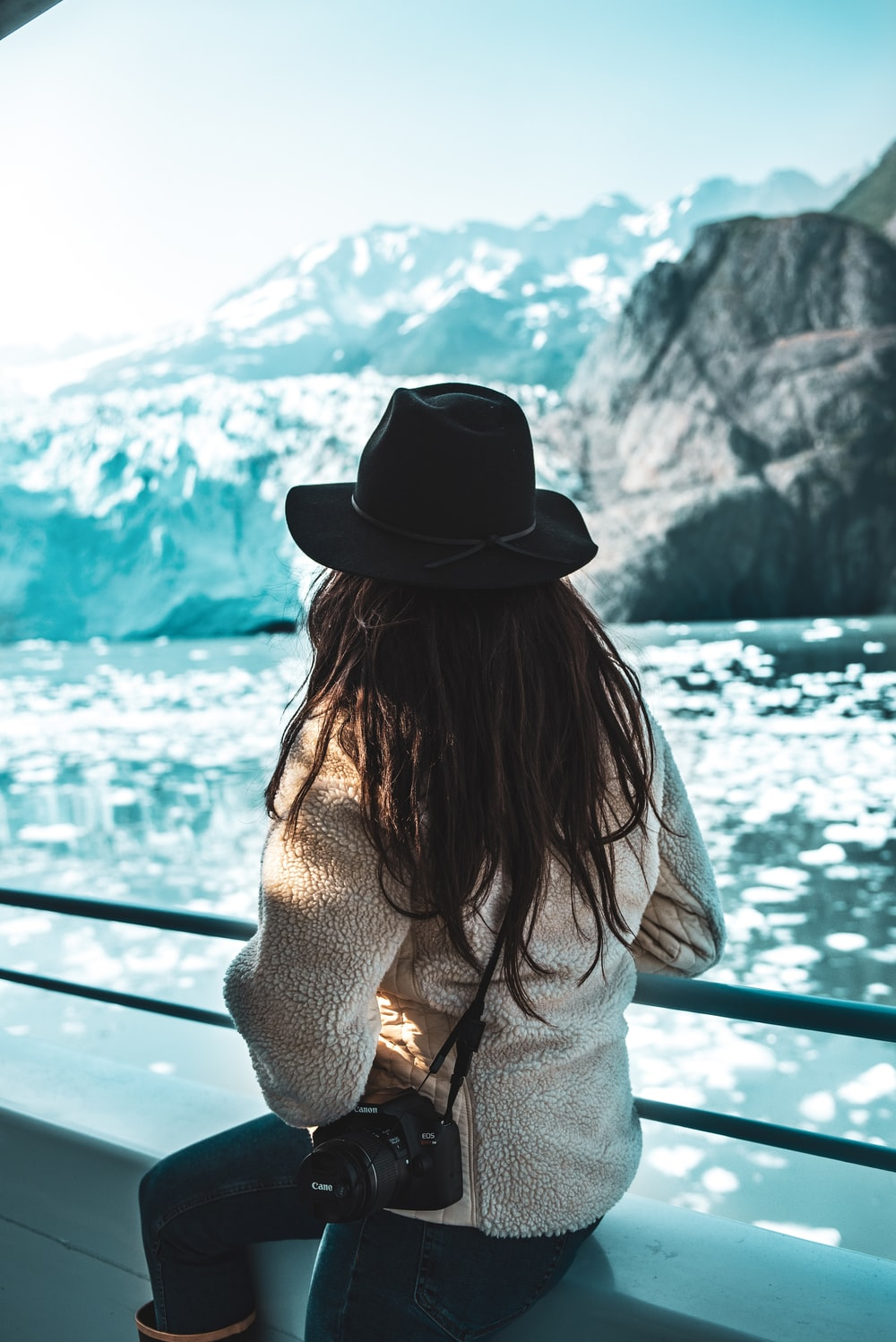woman with a DLSR camera with icebergs