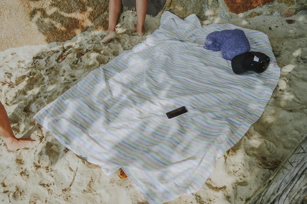 white and multicolored striped textile