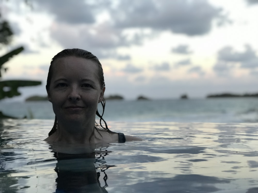 shallow focus photo of woman in body of water