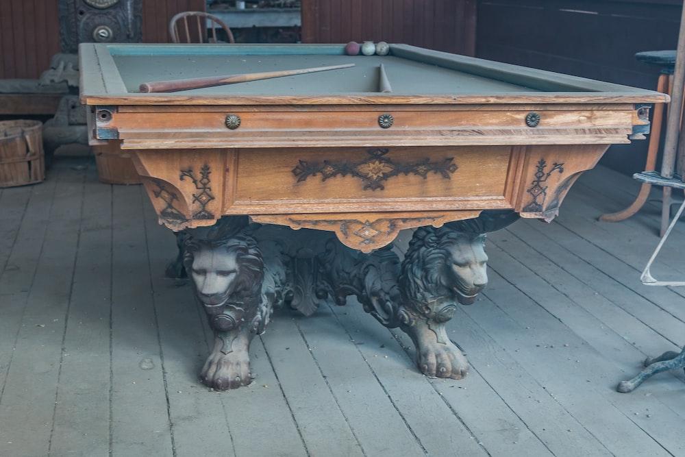 brown wooden billiard table