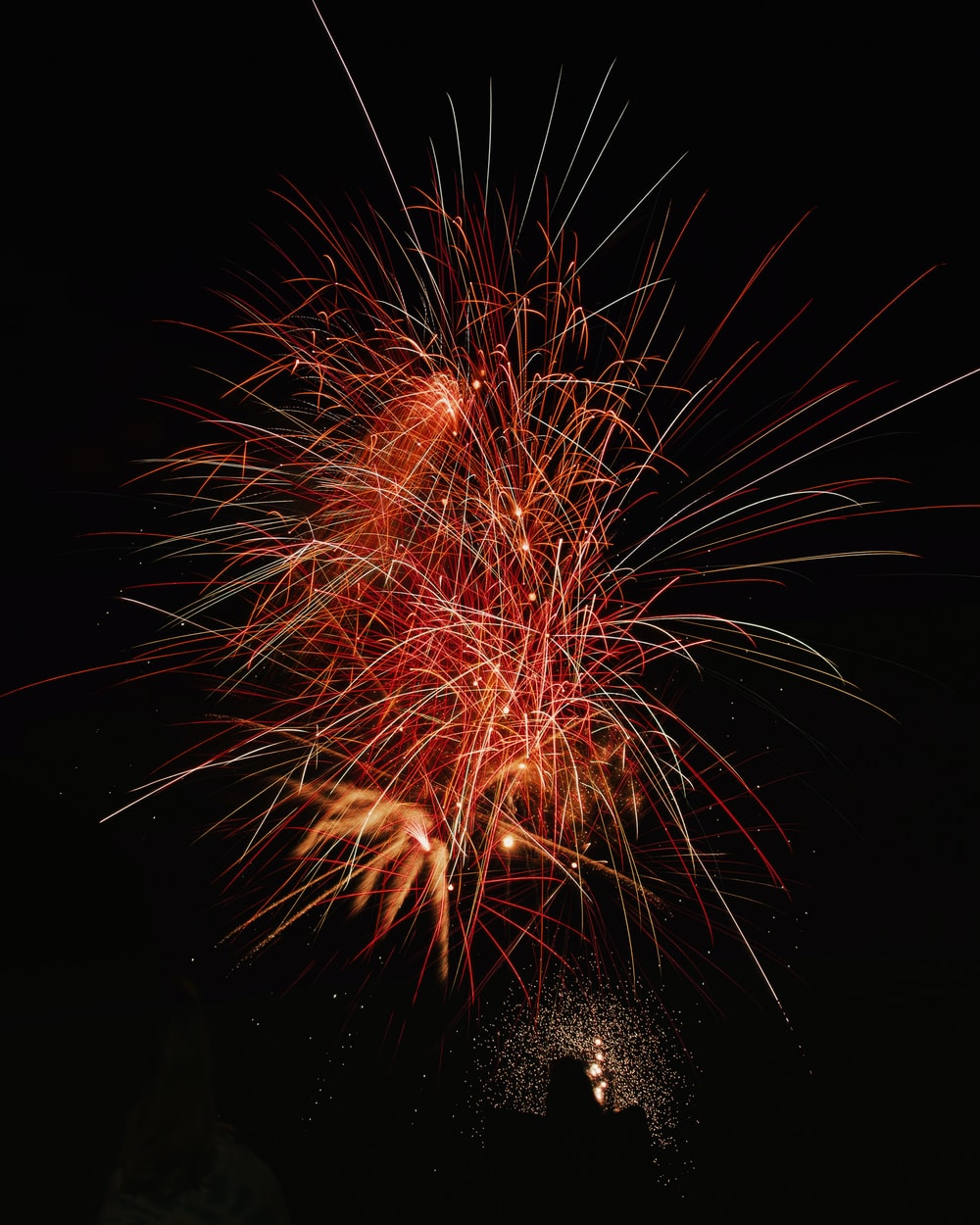 photography of red fireworks during nighttime