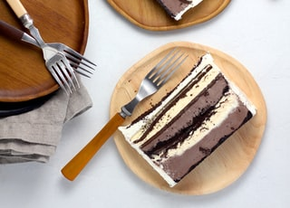sliced cakes on round brown wooden plates