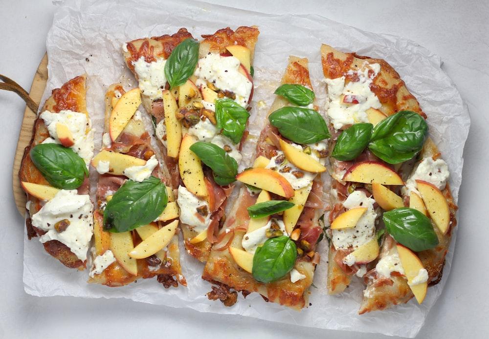 sliced pizza on white paper