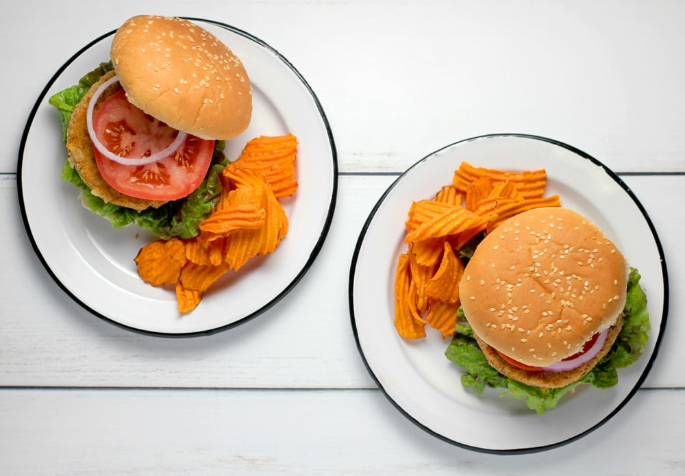burger dish on round white ceramic plates