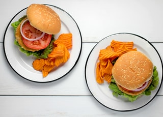 burger dish on round white ceramic plates