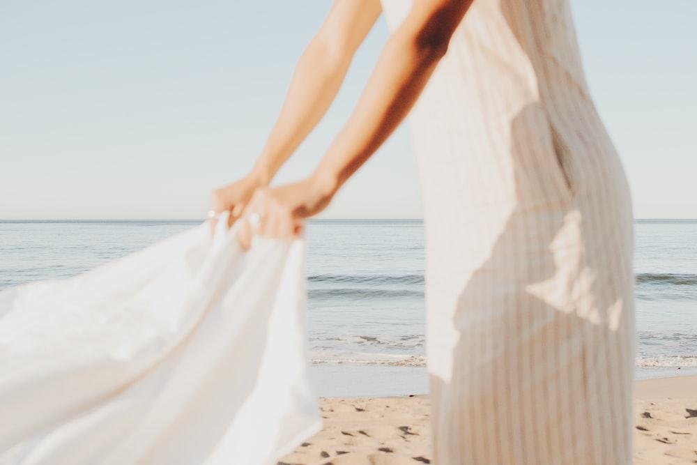 person wearing white dress during daytime