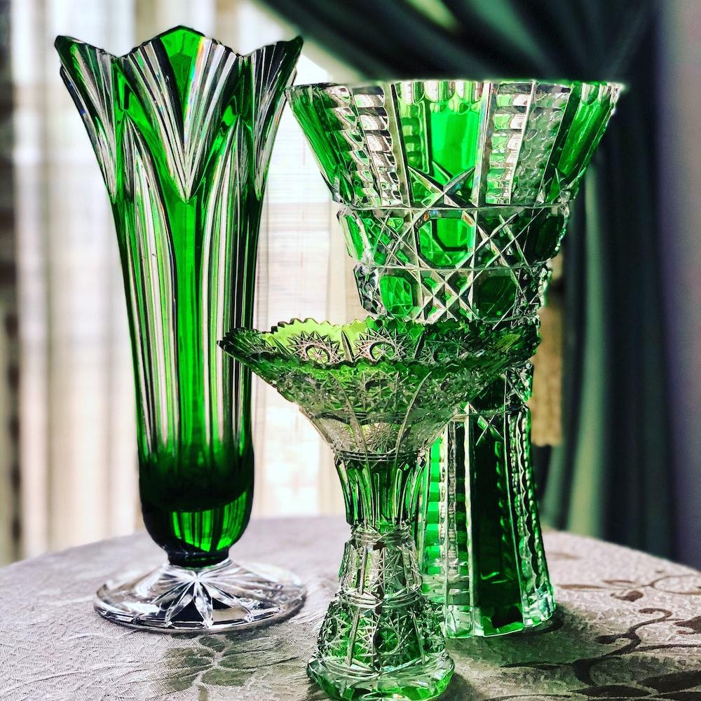 3 green glass vases