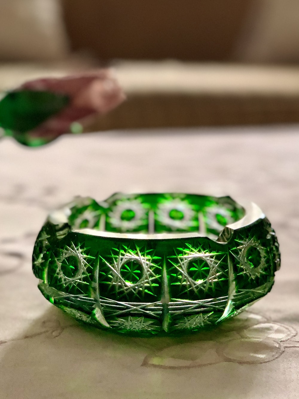 round green and white floral ashtray close-up photography