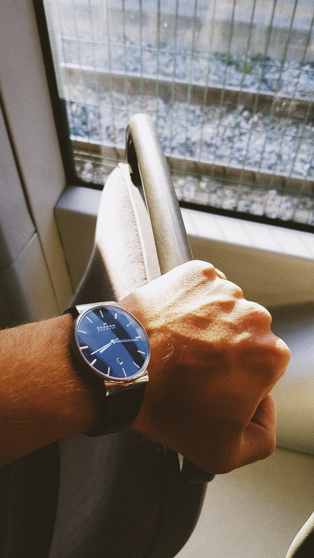 round blue and gold-colored analog watch