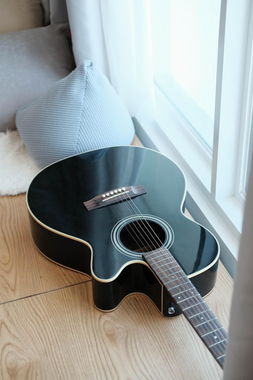 black cutaway acoustic guitar