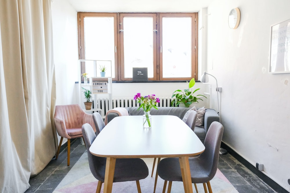 brown wooden table near wall