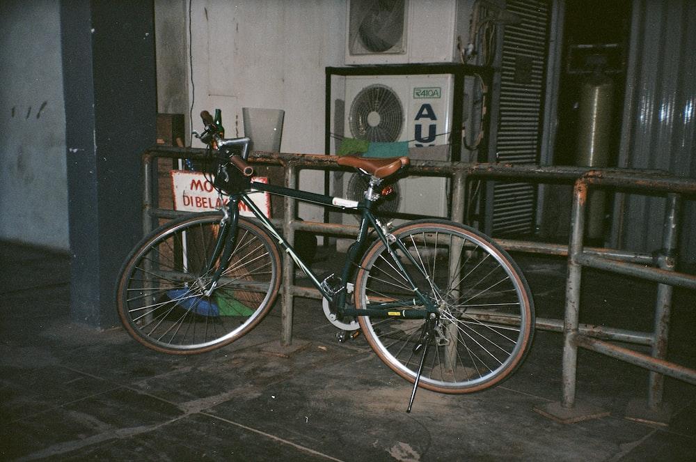 black and white bike near black railings