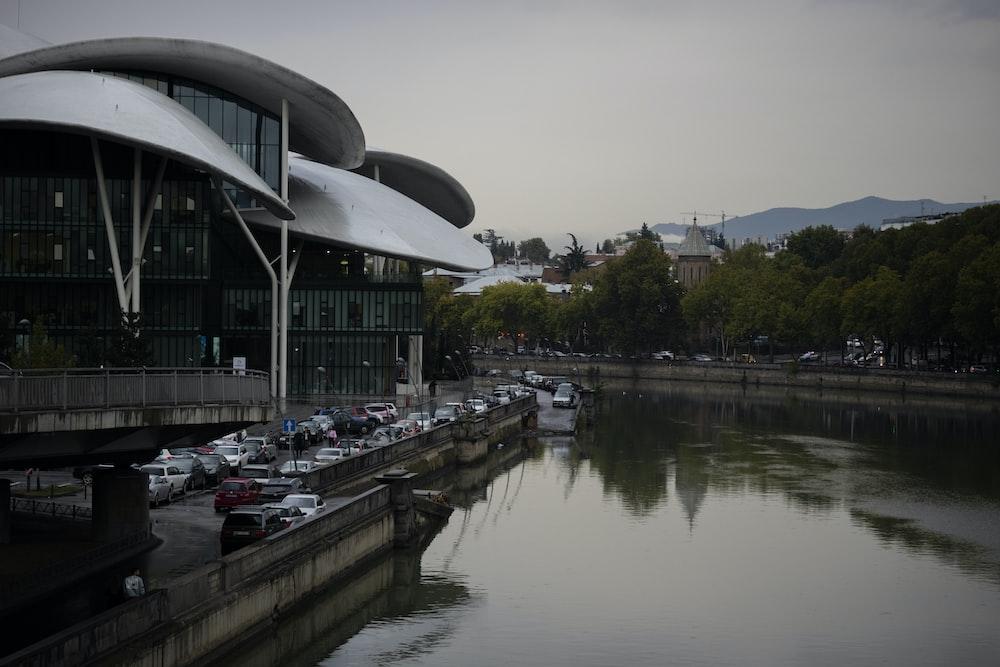 white building beside river
