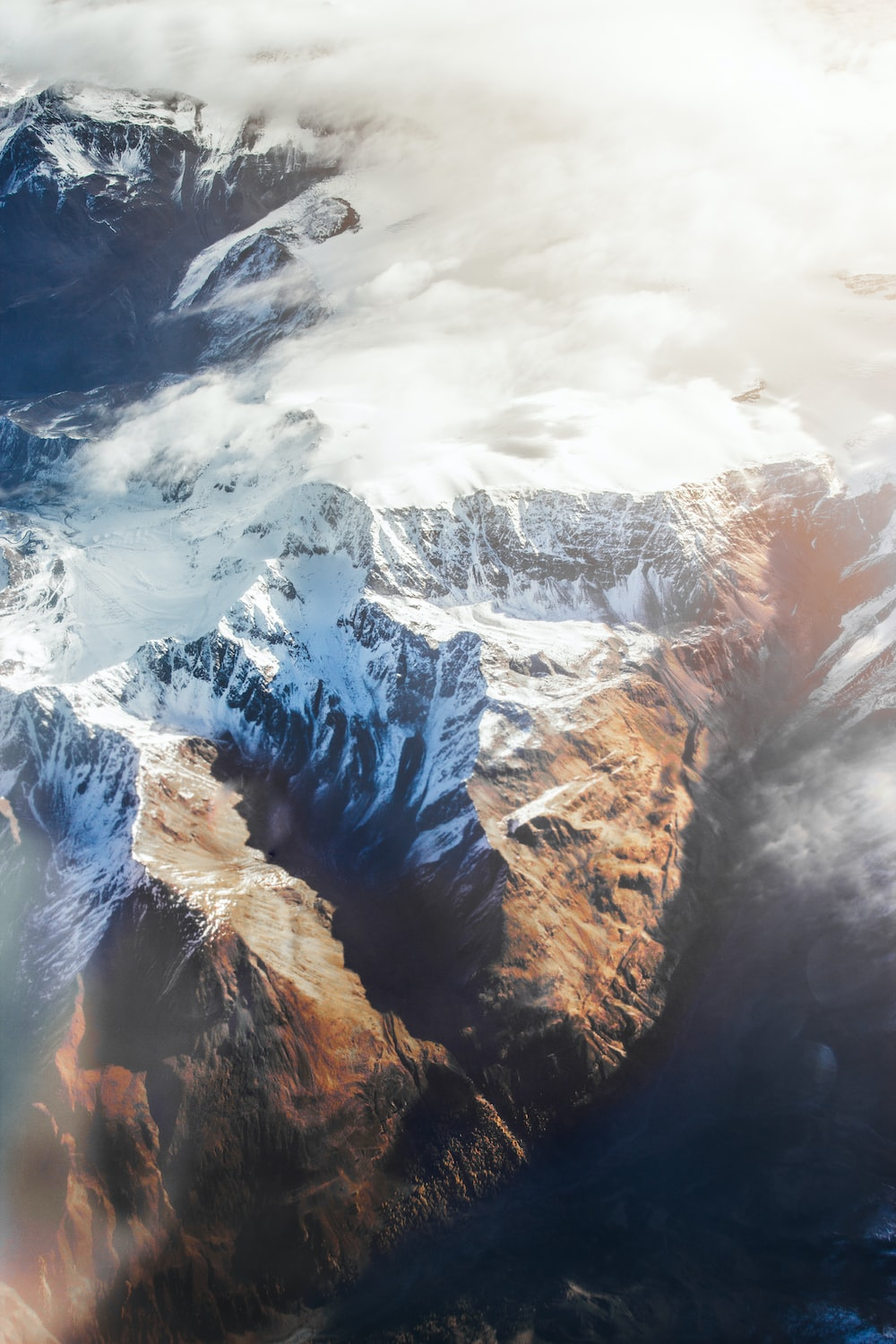 aerial photography of snow covered mountains