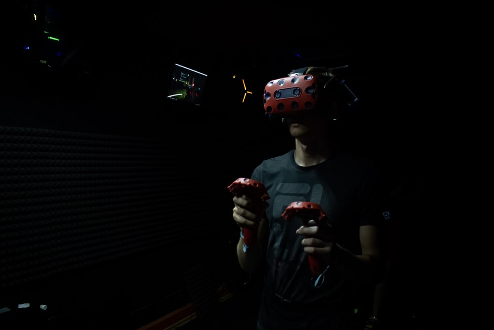 man wearing red virtual reality headset