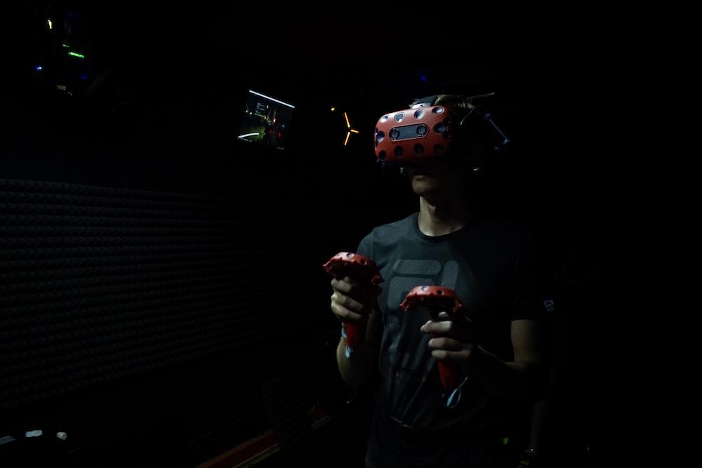 man wearing red virtual reality headset