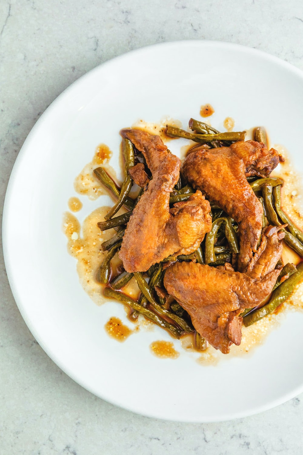 fried chicken wings in round white ceramic plate