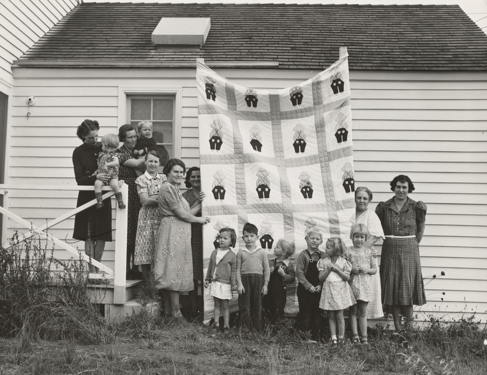 gray scale photo of family