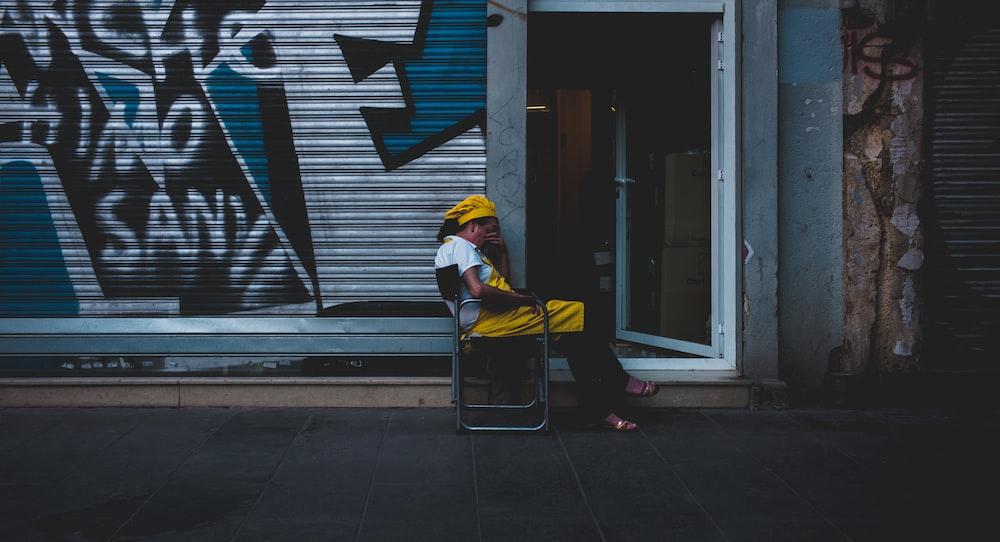 man sits near open door