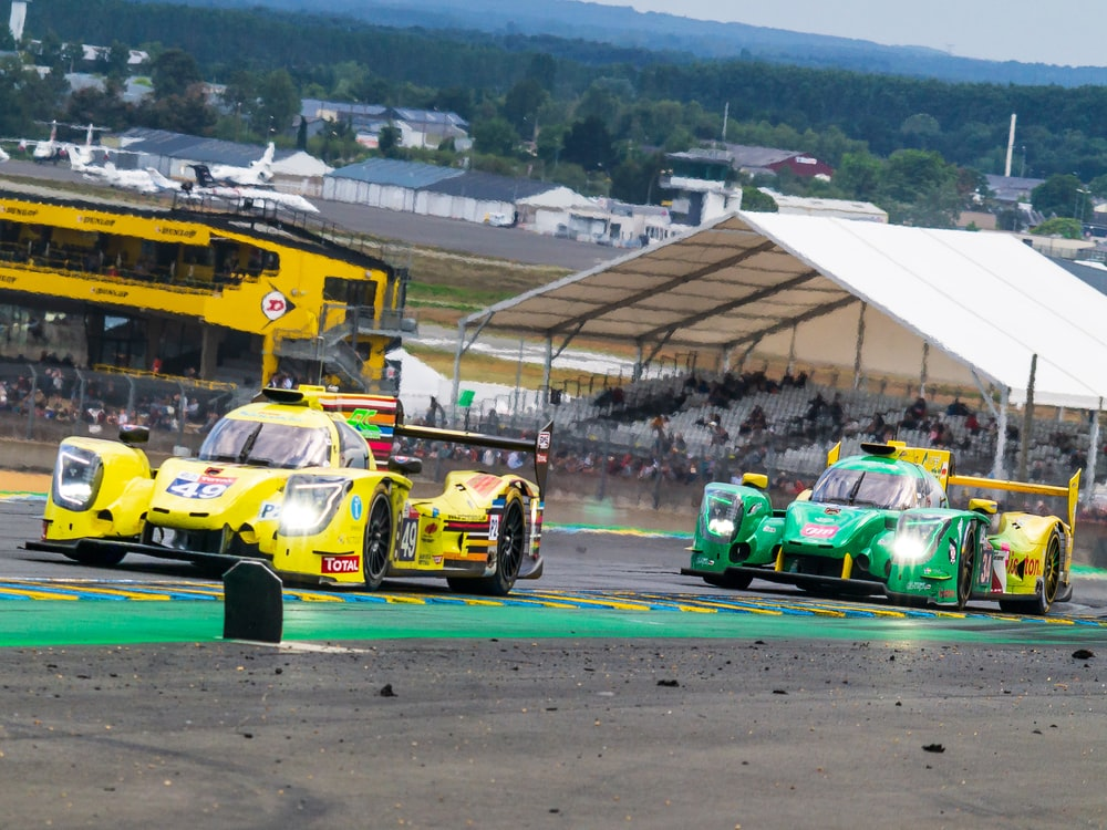 yellow and green racing cars on road