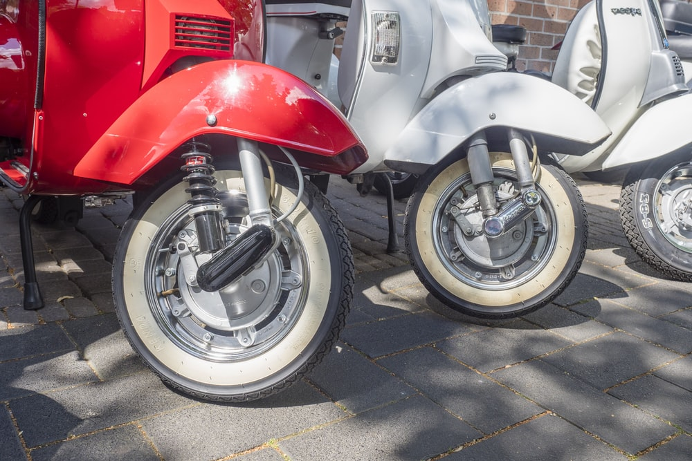 white and red motor scooters
