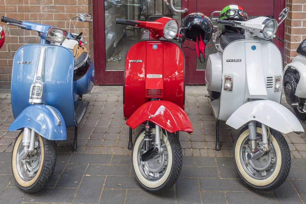 three motor scooters