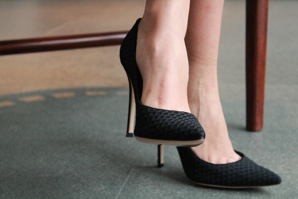 woman wearing black silettos
