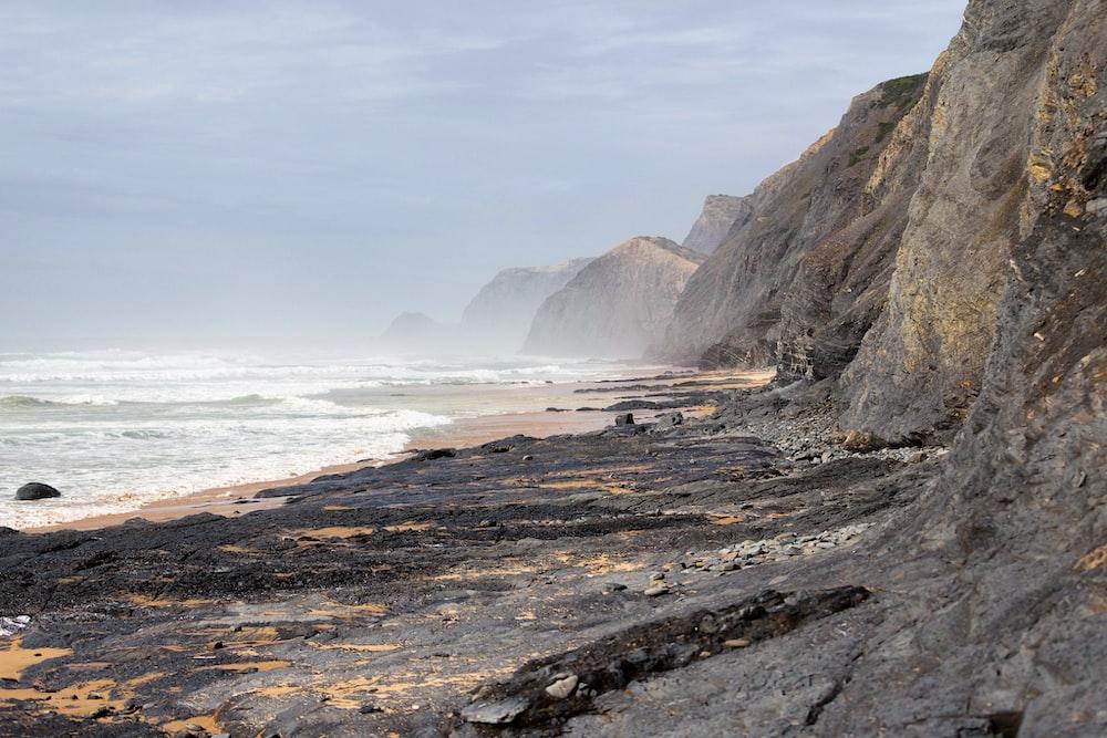 grey rock cliff at daytime