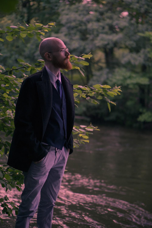 man standing near river